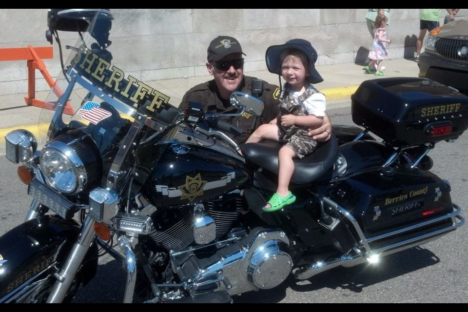 Motor Officer With a Harley Davidson Fan
