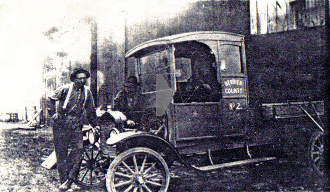 Workers Standing by a Model T